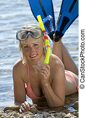 snorkel - woman on the beach with fins and snorkel