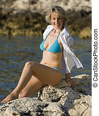 sun - young blond woman sunbathing on the beach