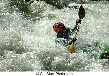 whitewater kayaking - adult male in class IV whitewater...