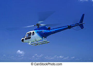 helicopter - a helicopter takes off in Barbados