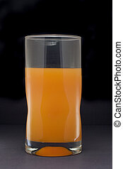 Orange juice glass - Tall glass holding orange juice...