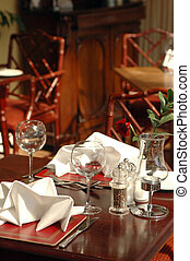 table setting - restaurant table setting with cane furniture