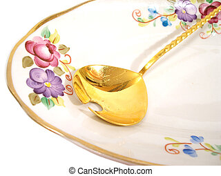 plate and spoon - beautiful plate and golden spoon over...