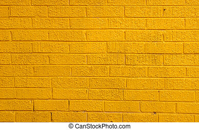 Yellow Brick Wall - A brightly painted yellow brick wall