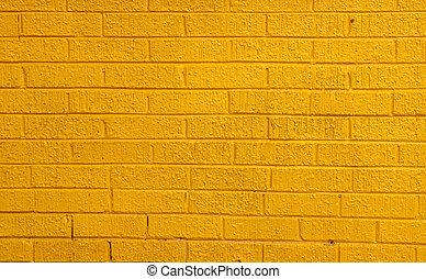 Yellow Brick Wall - A brightly painted yellow brick wall