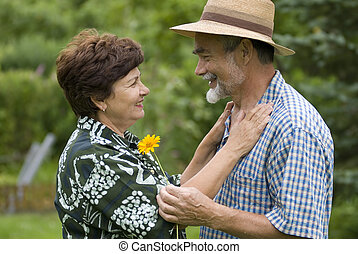 romantic senior couple II - Happy elderly couple embracing...
