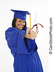 Teen - A female caucasian in navy blue graduation gown and...