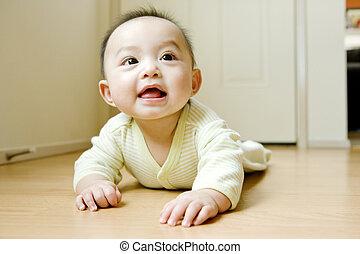 Baby Crawling On Floor - Baby (6-9 months) crawling on hard...