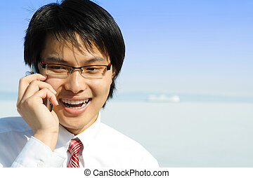 Busy businessman - A businessman talking on the phone...