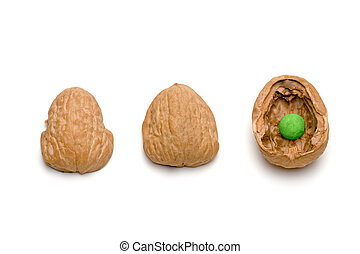 Shell Game II - A traditional shell game with three walnut...
