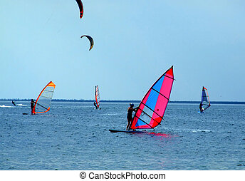 windsurfers, kitesurfers - windsurfers and kitesurfers on...