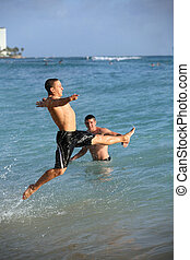 fun on the beach - Happy teen boys having fun on the beach