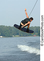 Wakeboarder in mid-jump