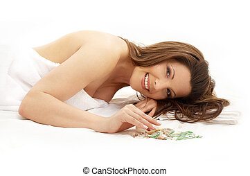 happy brunette in spa - picture of lovely lady relaxing in...
