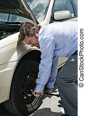 Flat Tire - Effort - A businessman with a flat tire on the...