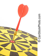 a dart on a dartboard, concept of success