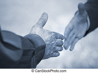 business handshake - hands of men (special toned photo f/x,...
