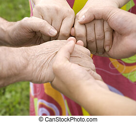 together - family concept focus point on hands of the woman...