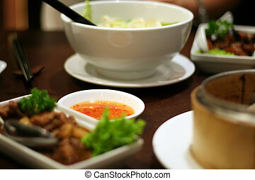 Traditional chinese cuisine, dishes with bowl of sauce