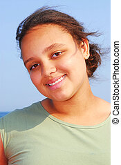 Young girl - Portrait of a beautiful young girl on sea shore...
