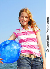 Young girl with beach ball - Portrait of a young beautiful...