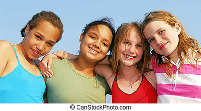 Four girls - Portrait of four smiling teenage girls outside