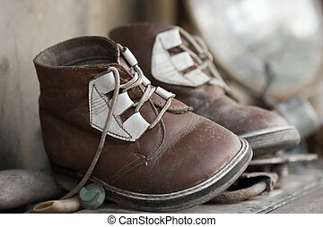 Old chid\\\'s shoes - The pair of old baby shoes. Childhood...