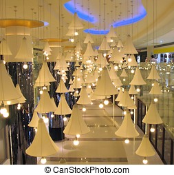 Modern Mall - -- with large lampshades hanging from the...