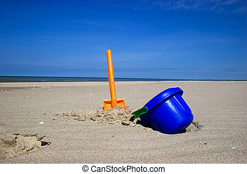 Beach spade and bucket - Orange plastic spade and blue...