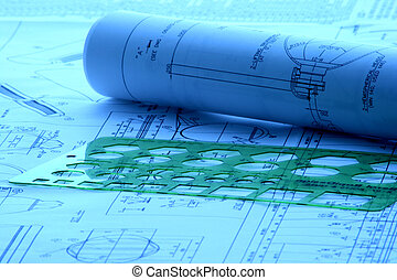 Blueprint laid with drafting tools