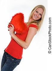 Happy young woman holding a heart - beautiful blond hair...