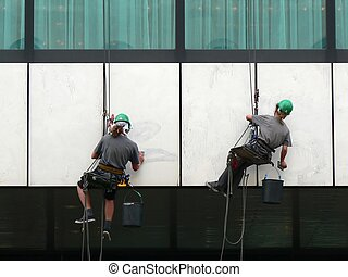 Men at work - Painters preparing a wall before painting it...