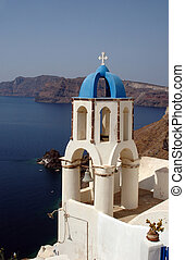 greek church bell tower over sea