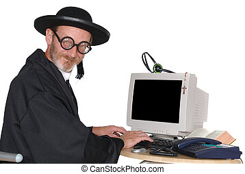 Priest on computer - Middle aged priest with bad eye sight...