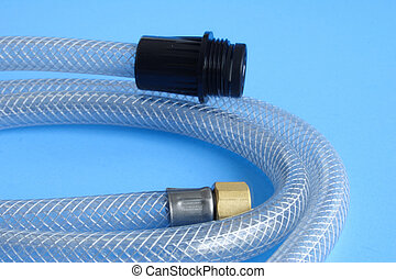tube - Plastic tube for water installation on blue...