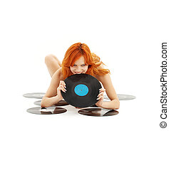 playful redhead with vinyl records over white