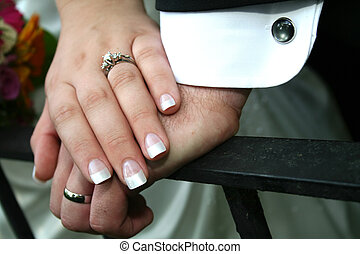 Wedding Hands - A bride and Groom\\\'s hands with bouquet of...