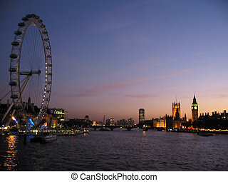 London Eye and Houses of - London, England and sunset