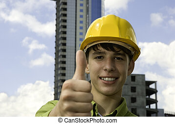 Good work - young worker with hard-hat on construction...