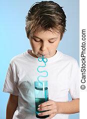 Boy drinks through straw