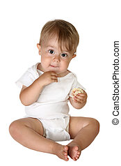 Adorable Baby Boy Eating - Baby boy sitting up and eating a...