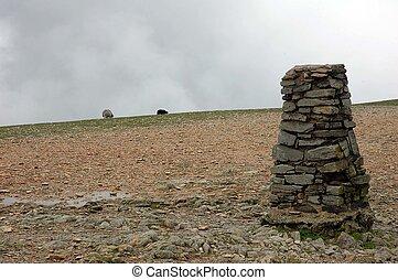Milestone Marker - A milestone marker on a mountain trail...