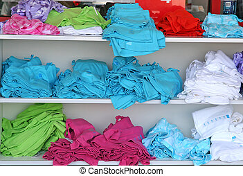 Colored Shirts - An array of multi colored tshirts on a...