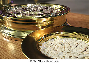 Communion Plates with the bread and wine ready to be served.