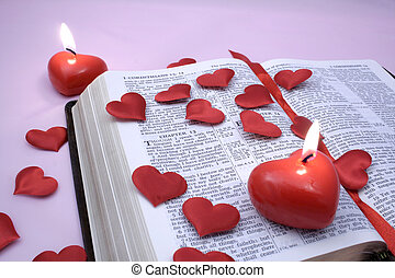 Love Chapter - Valentines Candles and hearts on a bible open...