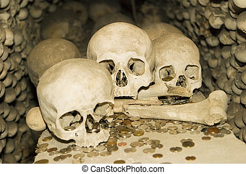 Bones and Coins - A detailed view of one of the crypts at...
