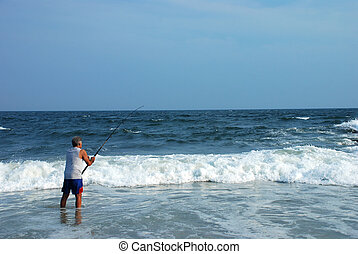 Beach Fishing - Man surf fishing on beach