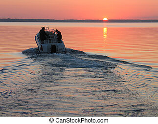 Speedboat in sunset - Speedboat sails into the sunset