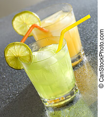 drink - cold orange and lemon drinks close up