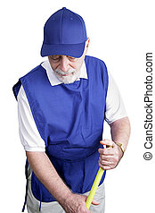 Senior Worker - Sweeping Up - A senior man sweeps up on his...